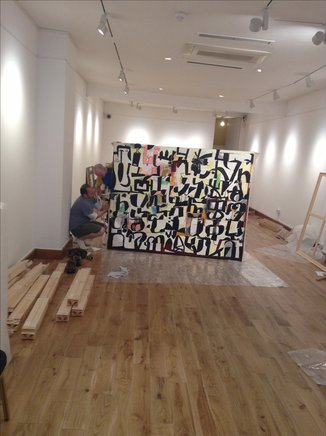 SETTING UP FOR THE WOSENE EXHIBITION AT GAFRA